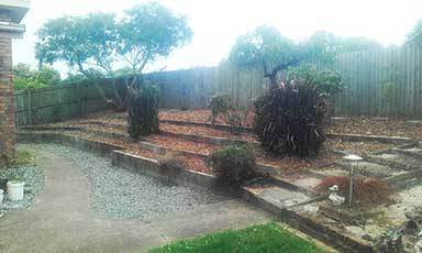 Garden tidy up after with mulch added
